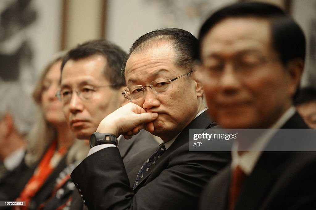 World Bank Group President Jim Yong Kim listens during a signing ceremony in Beijing on November 27, 2012. Jim Yong Kim started his first visit to China as Worldbank president on November 27 by signing an agreement with the Chinese government to launch a new knowledge platform to improve urban transport, focusing on low-carbon emissions, as China's fast growing cities are among the most polluted in the world.