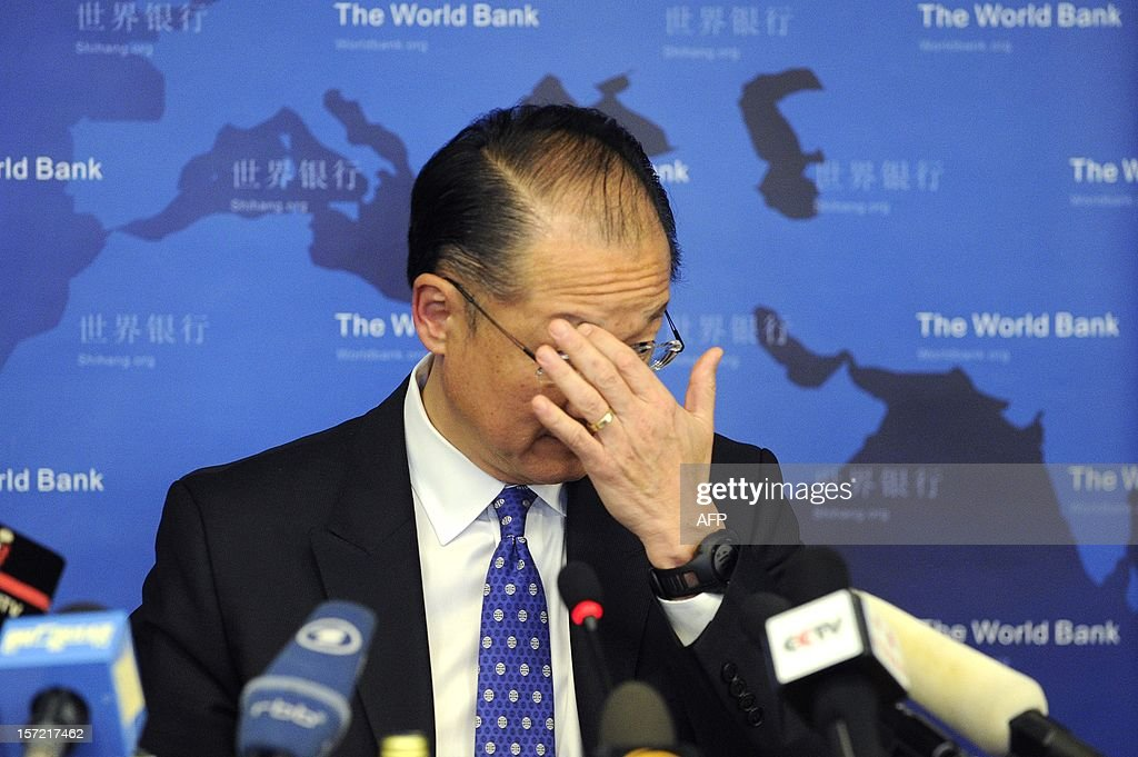 World Bank Group President Jim Yong Kim reacts at a press conference in Beijing on November 30, 2012. The World Bank is to launch a joint study with Beijing on urbanisation in China, one of the great human migrations of modern times, it said on November 30.
