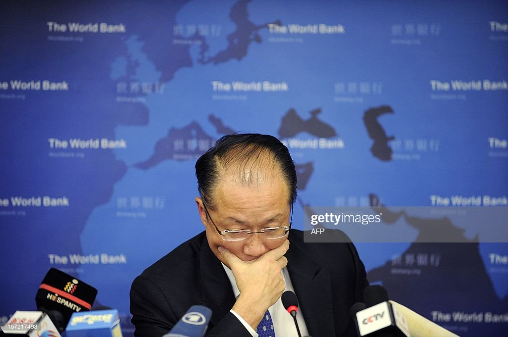World Bank Group President Jim Yong Kim reacts during a press conference in Beijing on November 30, 2012. The World Bank is to launch a joint study with Beijing on urbanisation in China, one of the great human migrations of modern times, it said on November 30. AFP PHOTO / WANG ZHAO