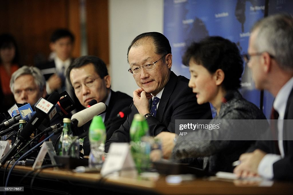 World Bank Group President Jim Yong Kim (C) reacts during a press conference in Beijing on November 30, 2012. The World Bank is to launch a joint study with Beijing on urbanisation in China, one of the great human migrations of modern times, it said on November 30.