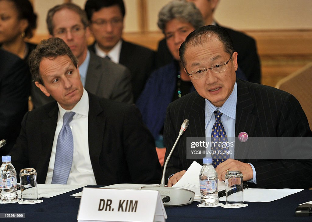 World Bank Group President Jim Yong Kim (R) speaks while US Treasury Secretary Timothy Geithner looks on at a high level meeting on the Global Agriculture and Food Security Program (GAFSP) in Tokyo on October 12, 2012 on the sidelines of the annual meetings of the International Monetary Fund and the World Bank in Tokyo on October 11, 2012. Heads of the IMF and World Bank are meeting in Japan from October 9 to 14. AFP PHOTO / Yoshikazu TSUNO