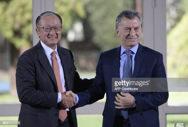World Bank President Jim Yong Kim and Argentina's President Mauricio Macri shake hands after a press conference at the Olivos presidential residence...