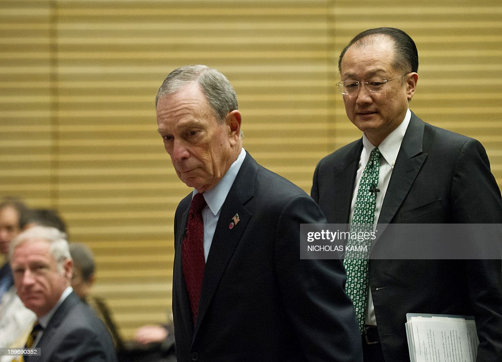World Bank President Jim Yong Kim (R) and New York City mayor Michael Bloomberg arrive to attend the annual Transforming Transportation conference at the World Bank in Washington,DC on January 18, 2013. AFP PHOTO/Nicholas KAMM