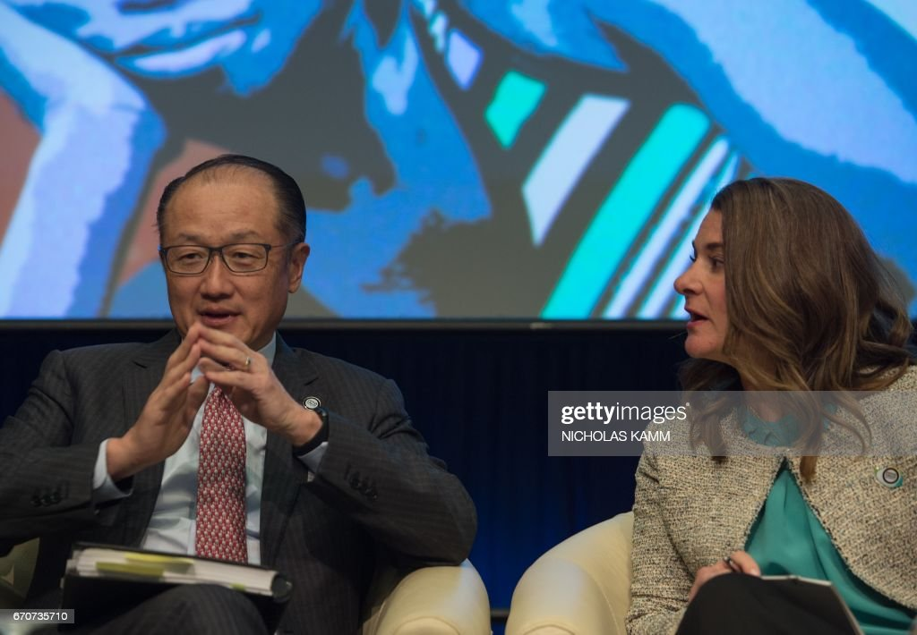 World Bank President Jim Yong Kim (L) chats with Melinda Gates, co-chair of the Bill and Melinda Gates Foundation, during a discussion entitled 'Generation Now - Investing in Adolescents Today to Shape the World of Tomorrow' at the IMF/WB Spring meetings in Washington, DC, on April 20, 2017. /