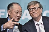 World Bank President Jim Yong Kim chats with Microsoft cofounder and philanthropist Bill Gates at a forum on financial development during the annual...