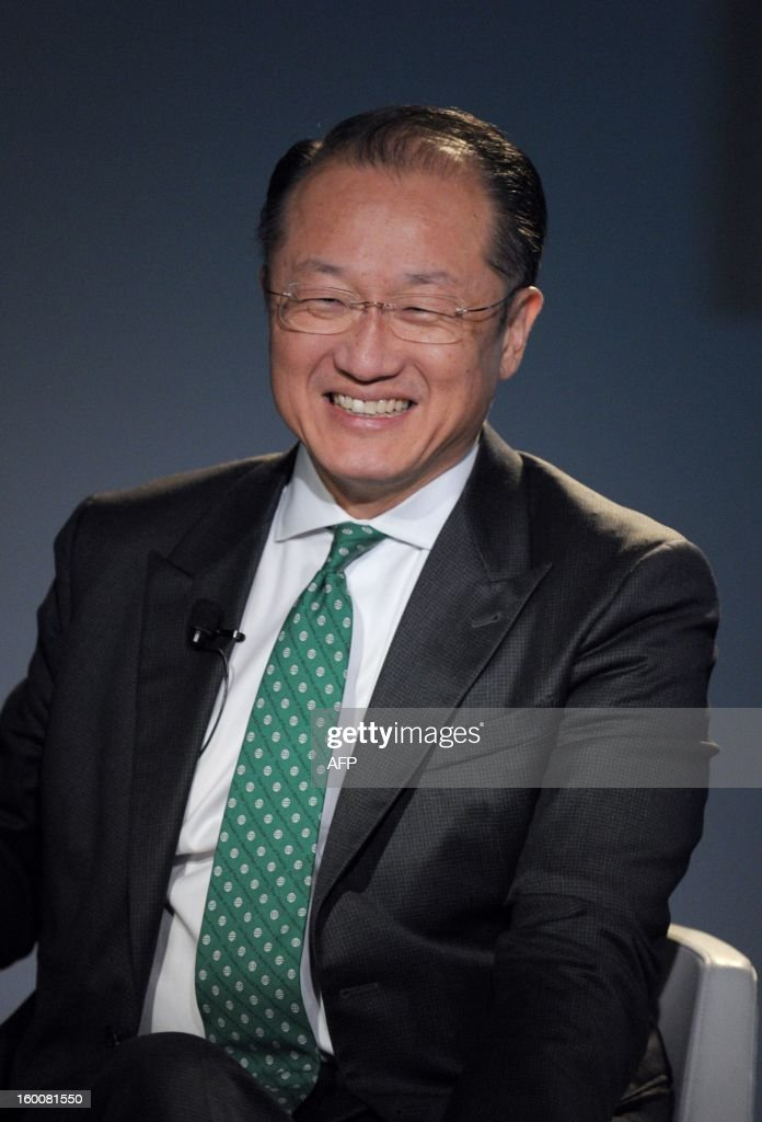 World Bank President Jim Yong Kim smiles on January 26, 2013, during the World Economic Forum (WEF) meeting in the Swiss resort of Davos. The WEF will see top politicians and business leaders pursue talks on whether they have seen the back of the global financial crisis. AFP PHOTO ERIC PIERMONT