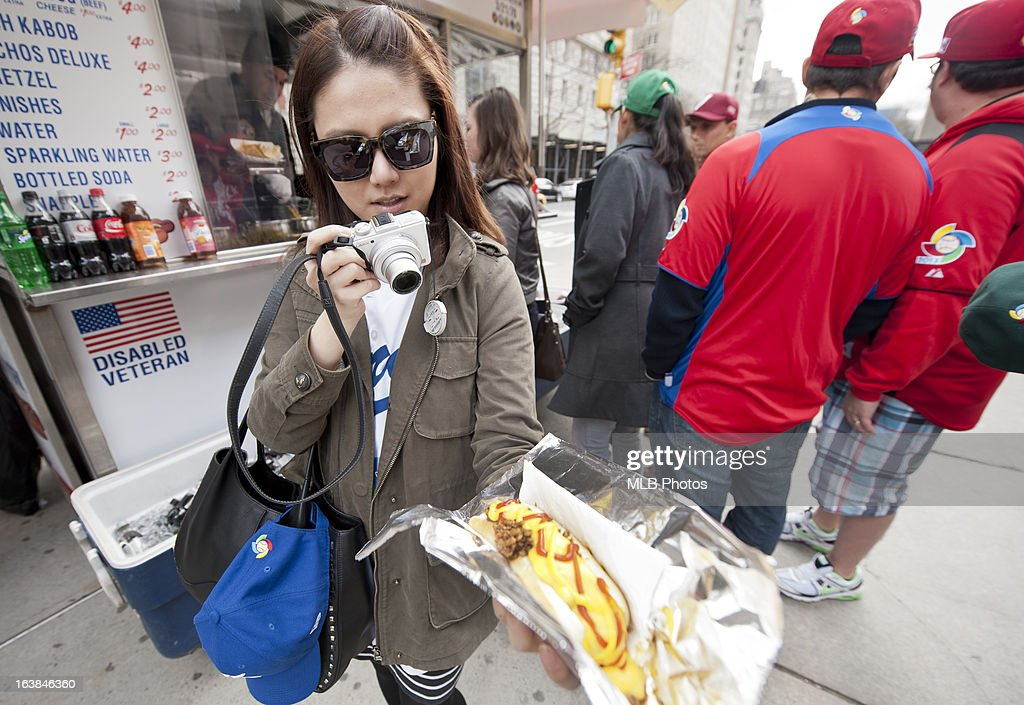 World Baseball Classic Cave Dweller Seo Soo Yeon takes a picture of her lunch outside the Metropolitan Museum of Art February 28, 2013 in New York City.