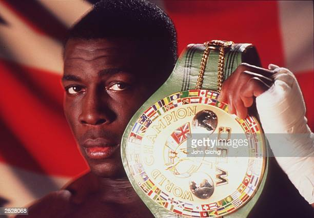 World Boxing Council heavyweight champion Frank Bruno of Great Britain poses with the WBC belt in this moody studio portrait taken in November 1995...