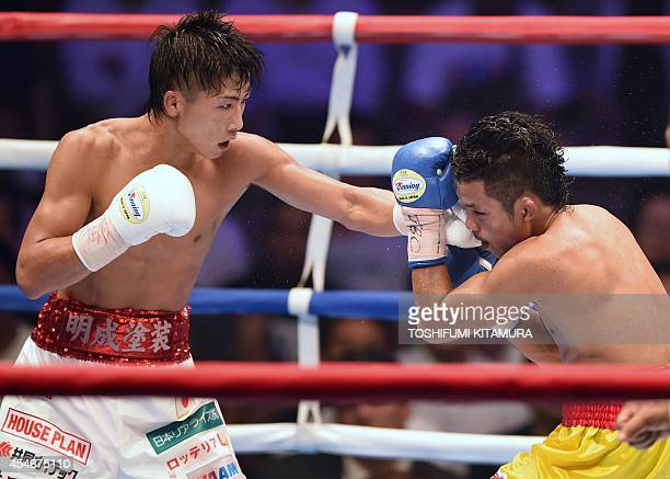 World Boxing Council light flyweight champion Naoya Inoue of Japan punches challenger Samartklek Kokietgym of Thailand during their title bout in...