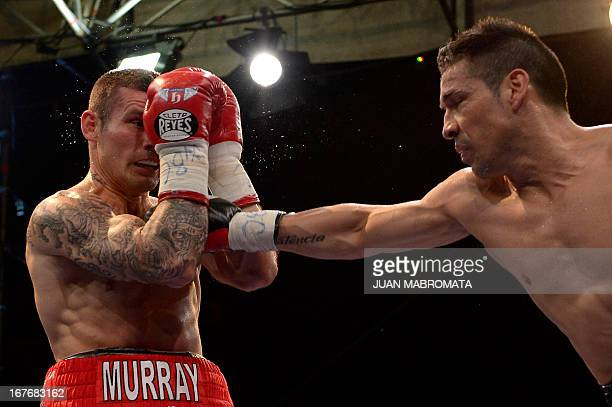 World Boxing Council middleweight defending champion Sergio 'Maravilla' Martinez of Argentina punches challenger Martin Murray of Britain during...