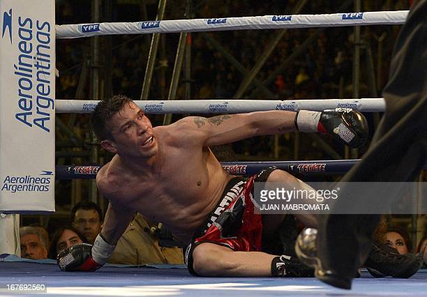 World Boxing Council middleweight defending champion Sergio 'Maravilla' Martinez of Argentina gestures afer falling during his title bout against...