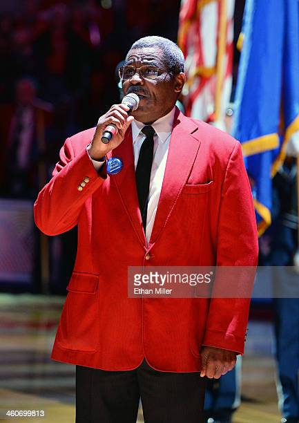 World Boxing Hall of Fame and California Boxing Hall of Fame referee Robert Byrd a UNLV usher sings the American national anthem before a game...