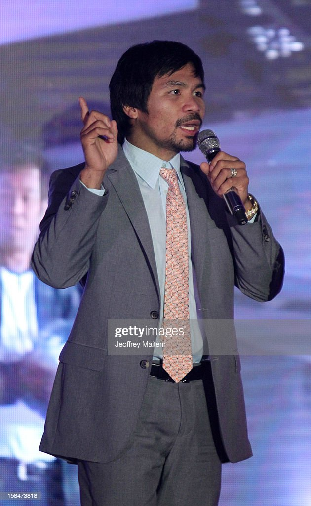 World boxing icon Manny Pacquiao speaks to supporters, family, friends and visitors, during his 34th birthday party on December 17, 2012 in General Santos, Philippines.