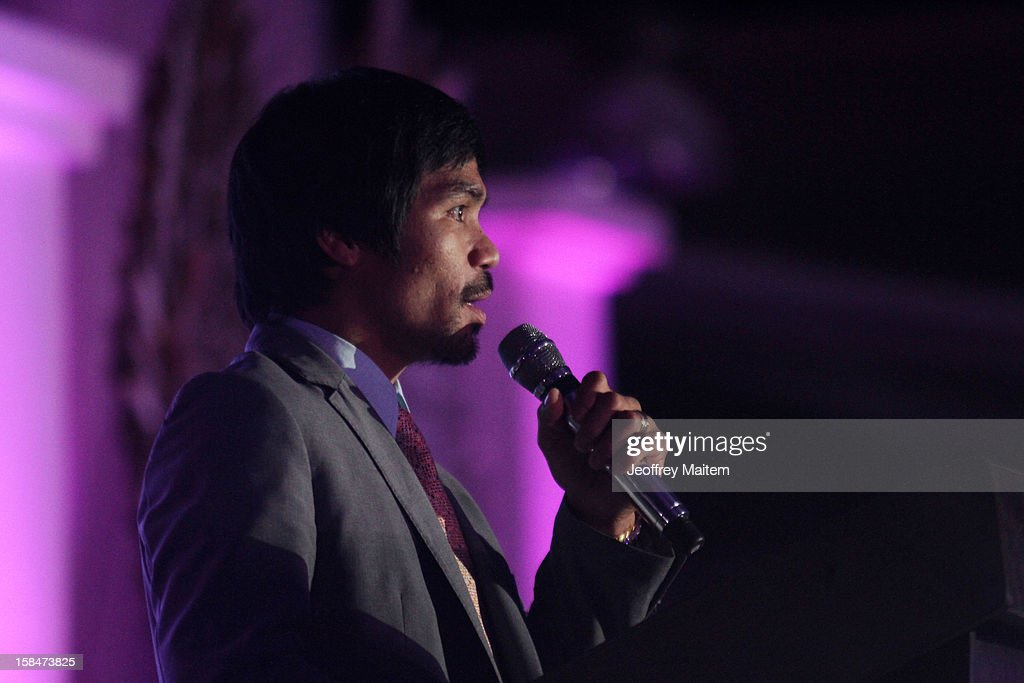 World boxing icon <a gi-track='captionPersonalityLinkClicked' href=/galleries/search?phrase=Manny+Pacquiao&family=editorial&specificpeople=3855506 ng-click='$event.stopPropagation()'>Manny Pacquiao</a> speaks to supporters, family, friends and visitors, during his 34th birthday party on December 17, 2012 in General Santos, Philippines.