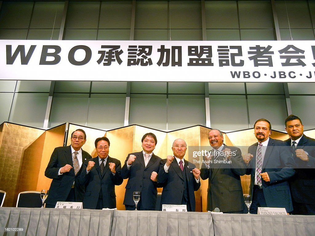 World Boxing Organization President Francisco Varcarcel (3R) and Japan Boxing Commission Commissioner Yuko Hayashi (4L) and other board members pose for photographs during a press conference on February 18, 2013 in Tokyo, Japan. JBC have only approved and joined World Boxing Association (WBA) and World Boxing Council (WBC).