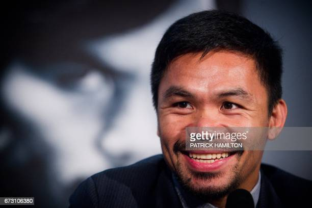 World Boxing Organization welterweight defending champion Manny Pacquiao reacts during a promotional press conference at Suncorp Stadium in Brisbane...
