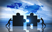 World Business teamwork puzzle pieces 3d rendering
