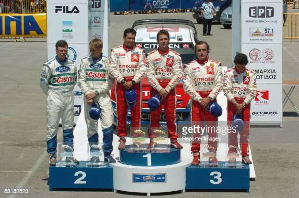 World chamion Sebastien Loeb of France and codriver Daniel Elena of Monte Carlo win first place Toni Gardemaister and codriver Jakke Honkanen of...