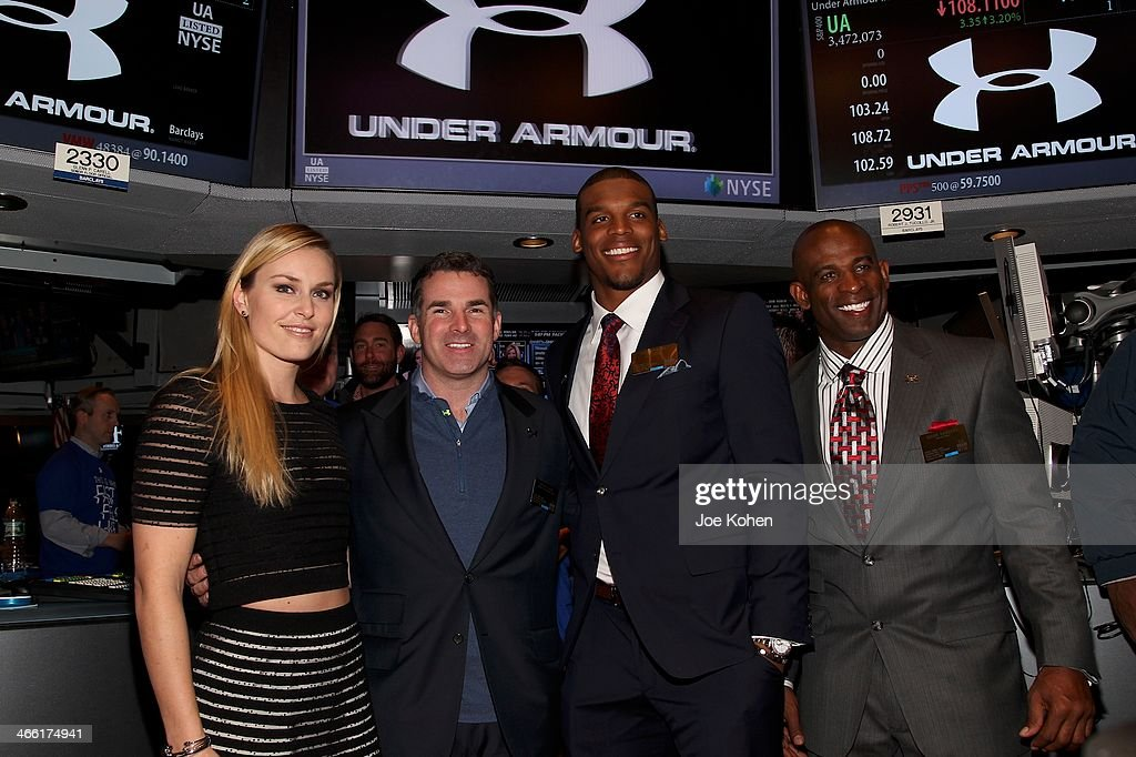 World Champion Alpine Ski Racer <a gi-track='captionPersonalityLinkClicked' href=/galleries/search?phrase=Lindsey+Vonn&family=editorial&specificpeople=4668171 ng-click='$event.stopPropagation()'>Lindsey Vonn</a> , Under Armour Founder and CEO Kevin Plank, Carolina Panthers Quarterback <a gi-track='captionPersonalityLinkClicked' href=/galleries/search?phrase=Cam+Newton+-+American+Football+Quarterback&family=editorial&specificpeople=4516761 ng-click='$event.stopPropagation()'>Cam Newton</a> and Football Hall of Famer <a gi-track='captionPersonalityLinkClicked' href=/galleries/search?phrase=Deion+Sanders&family=editorial&specificpeople=202222 ng-click='$event.stopPropagation()'>Deion Sanders</a> attend the closing bell at New York Stock Exchange on January 31, 2014 in New York City.