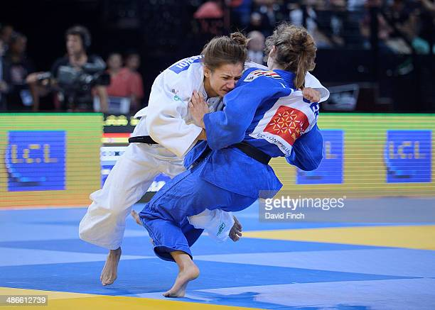 World champion and eventual u52kg gold medallist Majlinda Kelmendi of Kosovo throws Mareen Kraeh of Germany for ippon to reach the final during the...