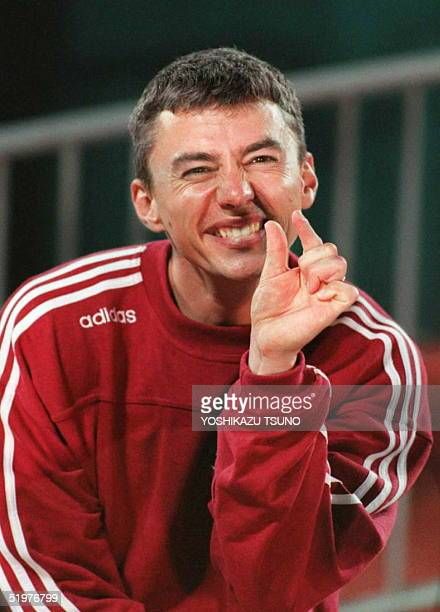 World champion and world recordholder Jonathan Edwards of Great Britain gestures after twice overstepping the mark in the men's Olympic triple jump...