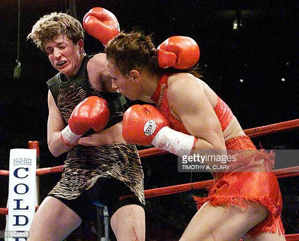 World Champion Bridgett Riley lands a punch to the head of Brenda Burnside during the women's attraction bout 13 March 1999 at Madison Square Garden...