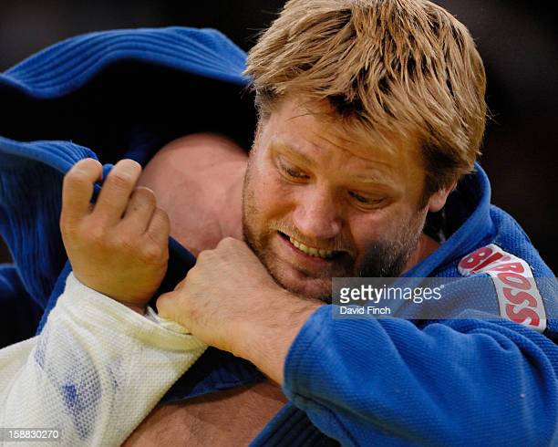 World champion Dennis Van der Geest of Holland attacks Kosei Inoue of Japan in their heavyweight quarterfinal but eventually lost by ippon during the...
