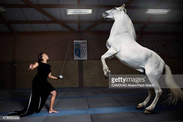 World champion fencer Laura Flessel is photographed for Paris Match with Nador a horse trained by Mario Luraschio June 11 2015 in BourglaReine France