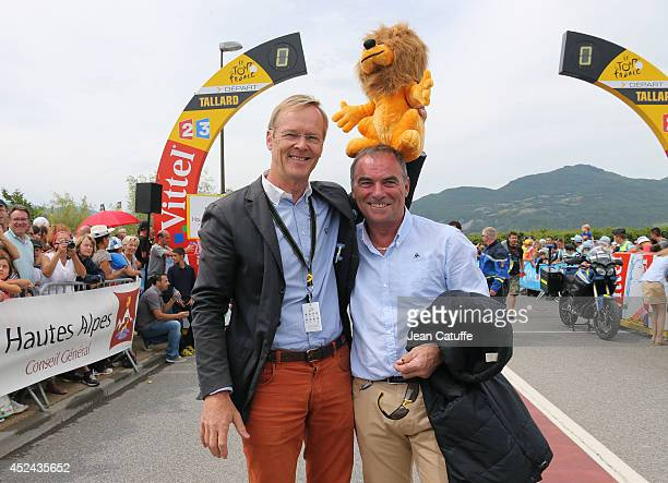 World champion in rally and four times winner of ParisDakar Ari Vatanen of Finland poses with five times winner of the Tour de France Bernard Hinault...