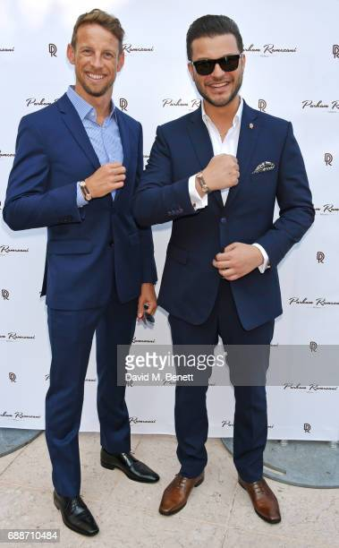 World Champion Jenson Button and Parham Ramezani pose at the launch of The Legacy Collection by Parham Ramezani on The Terrace Amber Lounge at Le...