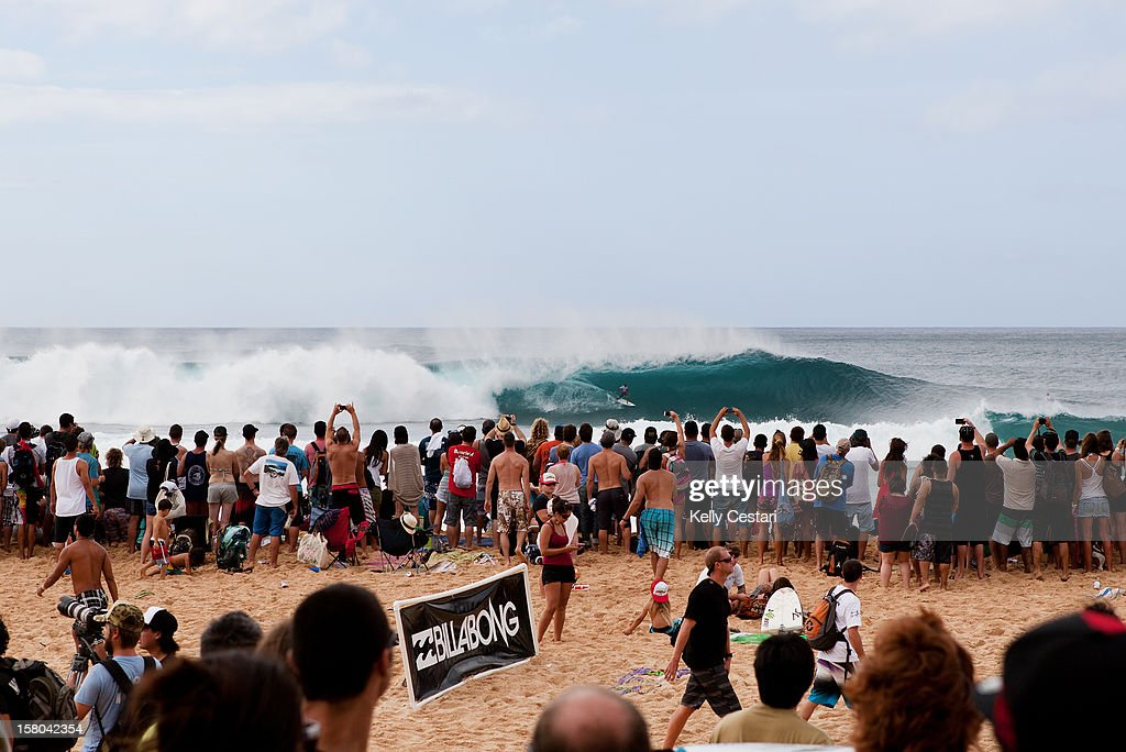 World Champion Kelly Slater of the United States stands tall inside a Pipeline barrel to thrill the crowds and win his Billabong Pipe Masters Round 3 heat on December 9, 2012 in North Shore, Hawaii.