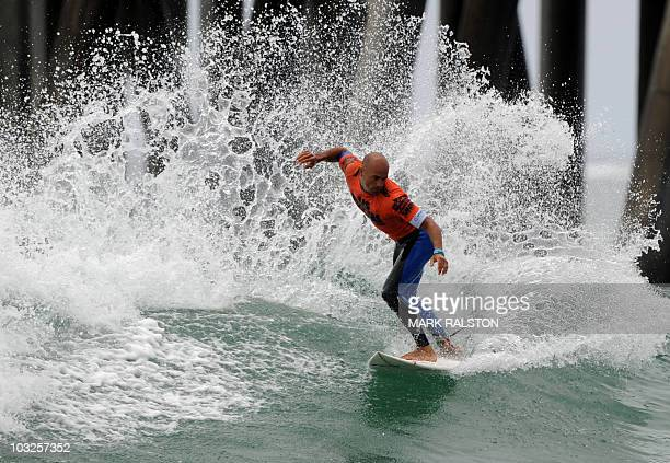 World Champion Kelly Slater of the US competes beside the pier during the men's third round heats of the US Open of Surfing at Huntington Beach...
