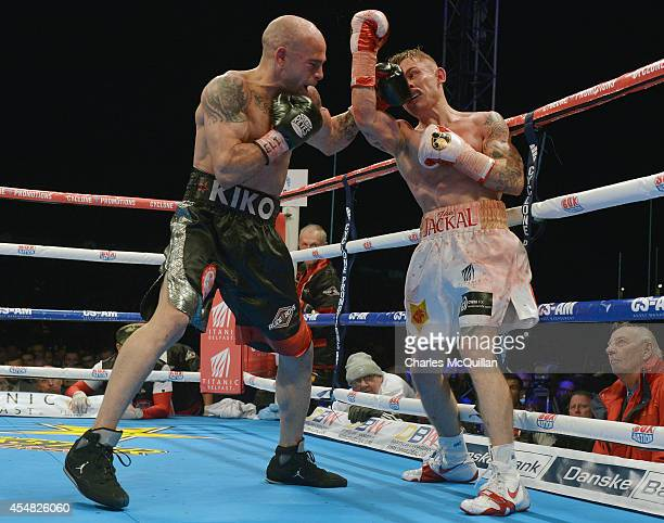 World champion Kiko Martinez of Spain lands a punch against Carl Frampton of Northern Ireland during their IBF superbantamweight world title bout at...