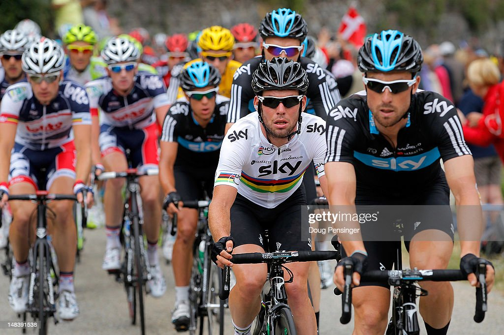 World Champion <a gi-track='captionPersonalityLinkClicked' href=/galleries/search?phrase=Mark+Cavendish&family=editorial&specificpeople=684957 ng-click='$event.stopPropagation()'>Mark Cavendish</a> (2R) of Great Britain riding for Sky Procycling follows the wheel of teammate <a gi-track='captionPersonalityLinkClicked' href=/galleries/search?phrase=Bernhard+Eisel&family=editorial&specificpeople=695991 ng-click='$event.stopPropagation()'>Bernhard Eisel</a> (R) of Austria on the climb of the Port de Lers as they defend the race leader's yellow jersey of <a gi-track='captionPersonalityLinkClicked' href=/galleries/search?phrase=Bradley+Wiggins&family=editorial&specificpeople=182490 ng-click='$event.stopPropagation()'>Bradley Wiggins</a> of Great Britain riding for Sky Procycling during stage fourteen of the 2012 Tour de France from Limoux to Foix on July 15, 2012 in Le Port, France.