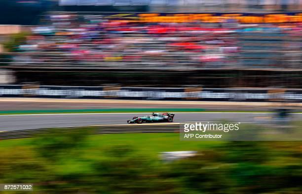 World Champion Mercedes' British driver Lewis Hamilton powers his car during the Brazilian Formula One Grand Prix practice session at the Interlagos...