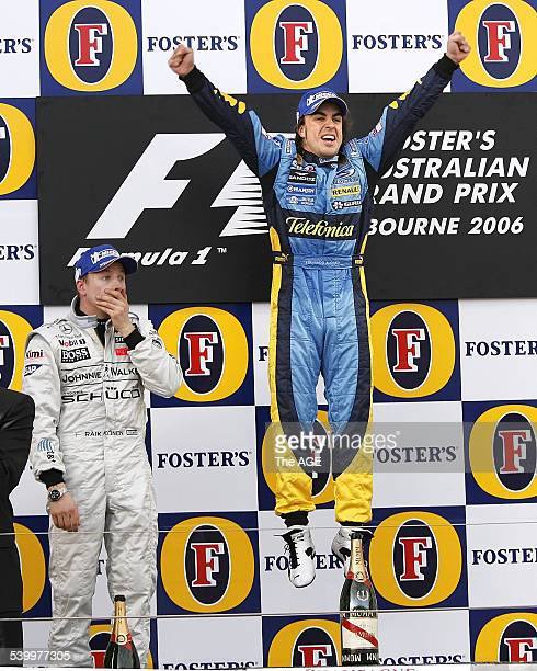 World champion Renault driver Fernando Alonso leaps into the air on the podium at Albert Park Melbourne after winning the 2006 Formula 1 Australian...
