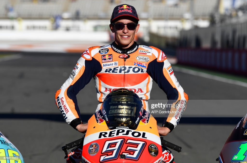 World Champion Repsol Honda Team's Spanish rider Marc Marquez poses after the MotoGP race of the Valencia Grand Prix at Ricardo Tormo racetrack in Cheste, near Valencia on November 12, 2017. Spain's Marc Marquez sealed his sixth world championship and fourth in the premier MotoGP category with third place at the Valencia Grand Prix. /