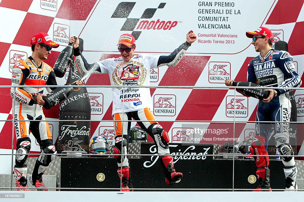 World champion Repsol Honda Team's Spanish rider <a gi-track='captionPersonalityLinkClicked' href=/galleries/search?phrase=Marc+Marquez&family=editorial&specificpeople=5409395 ng-click='$event.stopPropagation()'>Marc Marquez</a> (C), second-placed Repsol Honda Team's Spanish rider Dani Pedrosa (L) and race winner Yamaha Factory Racing's Spanish rider <a gi-track='captionPersonalityLinkClicked' href=/galleries/search?phrase=Jorge+Lorenzo&family=editorial&specificpeople=543869 ng-click='$event.stopPropagation()'>Jorge Lorenzo</a> celebrate on the podium of the Moto GP race of the Valencia Grand Prix at Ricardo Tormo racetrack in Cheste, Spain.