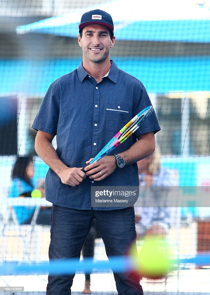 World Champion surfer Joel Parkinson plays tennis with kids from the tennis HotShots during day fourteen of the 2013 Australian Open at Melbourne Park on January 27, 2013 in Melbourne, Australia.