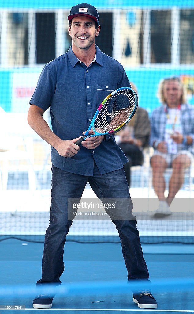 World Champion surfer <a gi-track='captionPersonalityLinkClicked' href=/galleries/search?phrase=Joel+Parkinson&family=editorial&specificpeople=234875 ng-click='$event.stopPropagation()'>Joel Parkinson</a> plays tennis with kids from the tennis HotShots during day fourteen of the 2013 Australian Open at Melbourne Park on January 27, 2013 in Melbourne, Australia.