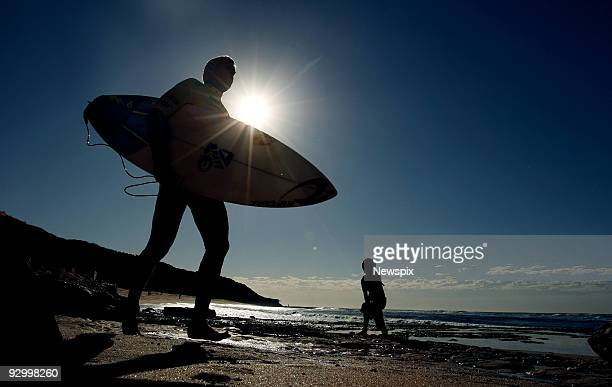 World Champion Surfer Mick Fanning heads out for his heat at the Bells Beach Pro surfing contest at Bells Beach on April 14 2009 in Melbourne...