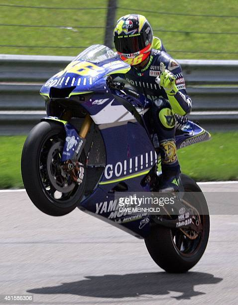 World champion Valentino Rossi of Italy does a 'wheely' after winning the German motorcycling Grand Prix at the Sachsenring in HohensteinErnstthal 31...