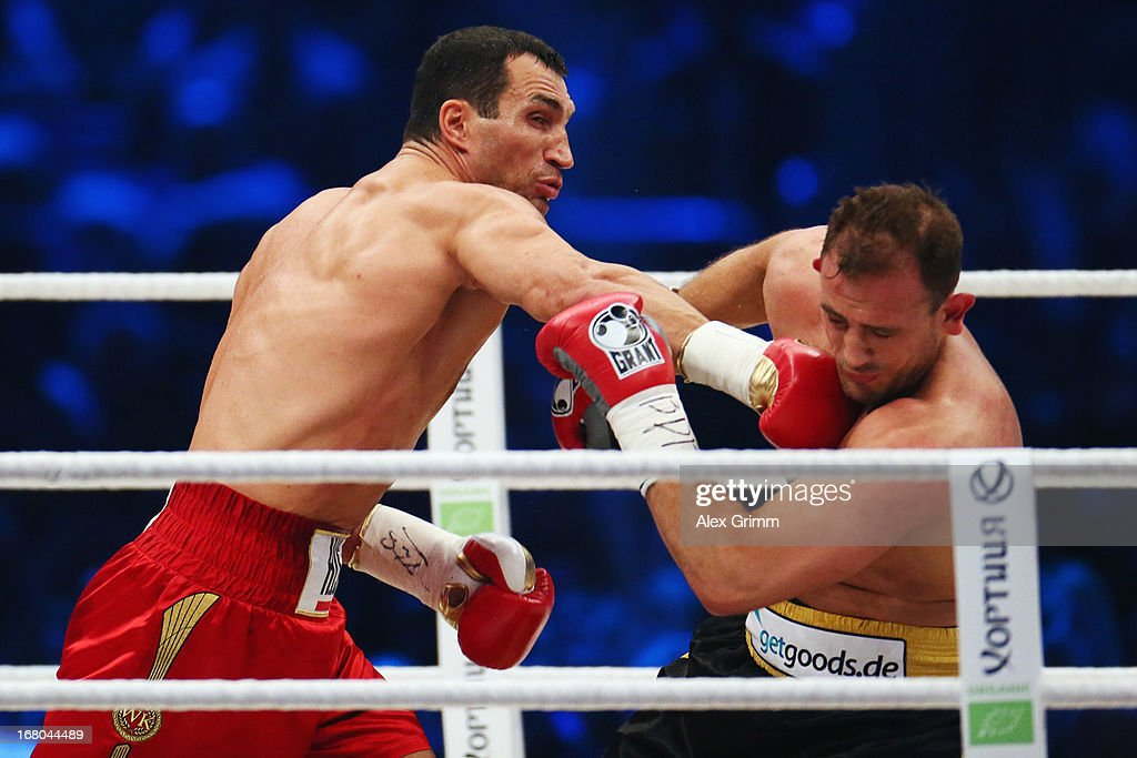 World Champion <a gi-track='captionPersonalityLinkClicked' href=/galleries/search?phrase=Wladimir+Klitschko&family=editorial&specificpeople=210650 ng-click='$event.stopPropagation()'>Wladimir Klitschko</a> (L) of Ukraine delivers a punch to challenger Francesco Pianeta during their IBF IBO WBA WBO World Championship fight at SAP Arena on May 4, 2013 in Mannheim, Germany.