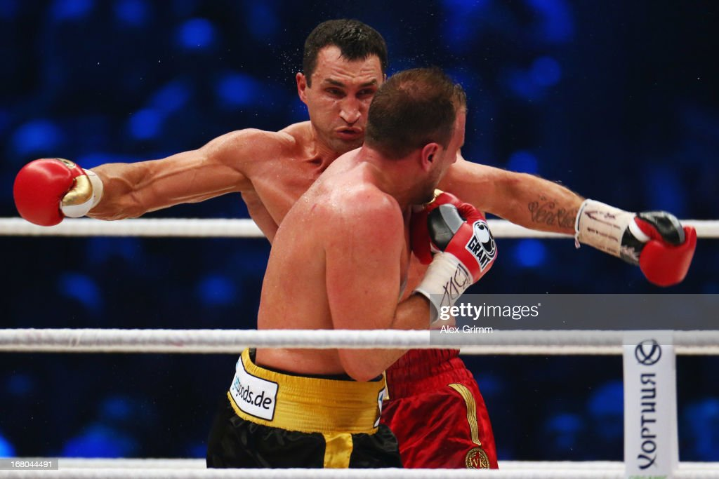World Champion <a gi-track='captionPersonalityLinkClicked' href=/galleries/search?phrase=Wladimir+Klitschko&family=editorial&specificpeople=210650 ng-click='$event.stopPropagation()'>Wladimir Klitschko</a> (back) of Ukraine delivers a punch to challenger Francesco Pianeta during their IBF IBO WBA WBO World Championship fight at SAP Arena on May 4, 2013 in Mannheim, Germany.