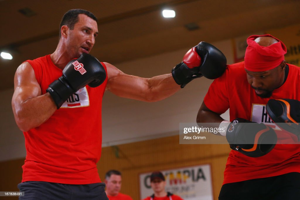 World Champion <a gi-track='captionPersonalityLinkClicked' href=/galleries/search?phrase=Wladimir+Klitschko&family=editorial&specificpeople=210650 ng-click='$event.stopPropagation()'>Wladimir Klitschko</a> of Ukraine exercises with his coach Johnathan Banks during the official training session ahead of his IBF, WBA, WBO and IBO World Championship fight against challenger Francesco Pianeta on May 1, 2013 in Heidelberg, Germany.
