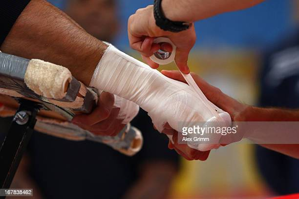 World Champion Wladimir Klitschko of Ukraine gets his hands bandaged during the official training session ahead of his IBF WBA WBO and IBO World...