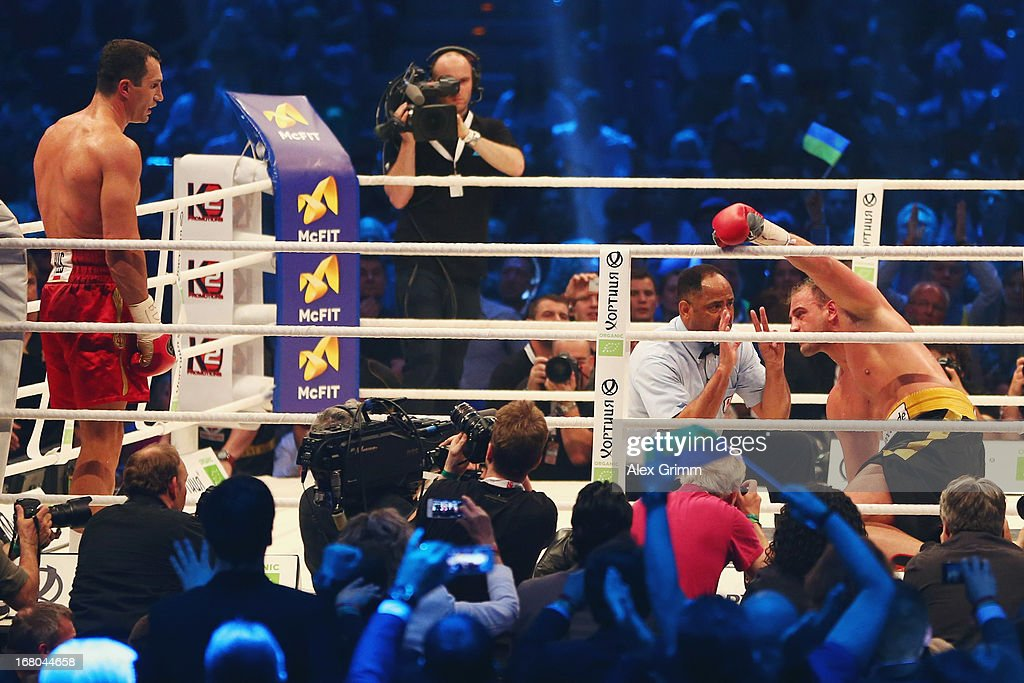 World Champion Wladimir Klitschko of Ukraine waits in the corner as referee Ernest Sharif kneels in front of challenger Francesco Pianeta and stops their IBF IBO WBA WBO World Championship fight at SAP Arena on May 4, 2013 in Mannheim, Germany.