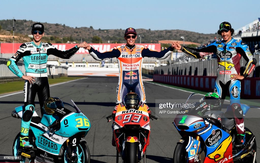 World Champions Leopard Racing Spanish rider from Spain Joan Mir, Repsol Honda Team's Spanish rider Marc Marquez and EG 0,0 Marc VDS Italian rider Franco Morbidelli pose after the MotoGP race of the Valencia Grand Prix at Ricardo Tormo racetrack in Cheste, near Valencia on November 12, 2017. Spain's Marc Marquez sealed his sixth world championship and fourth in the premier MotoGP category with third place at the Valencia Grand Prix. /