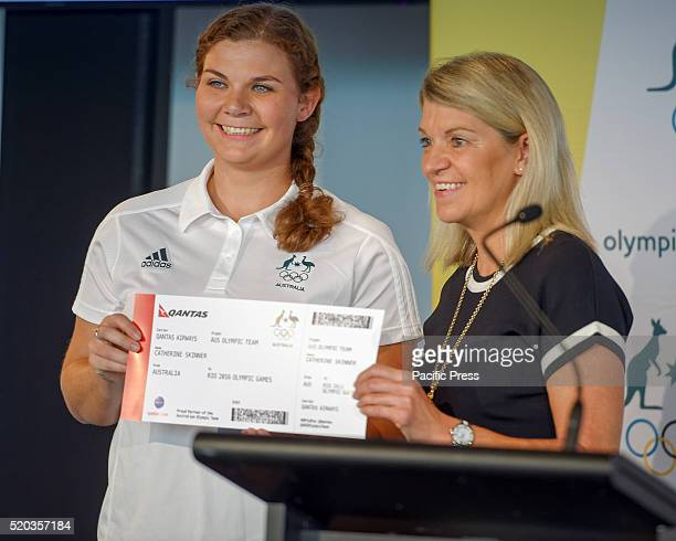 World championship medallist Catherine Skinner receives her boarding pass for Rio from Chef de Mission of the 2016 Australian Olympic Team Kitty...
