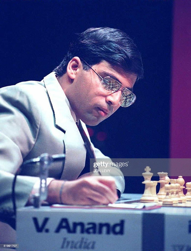 World Chess challenger Vichy Anand of India writes down his move in the first match of the World Chess Championship against champion Gary Kasparov from Russia 11 September in New York. The two chess Grand Masters will be playing for the title of World Chess Champion with the winner collecting USD 1 million in prize money.